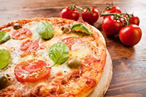 Bilder Pizza Tomaten Nahaufnahme Königskraut das Essen