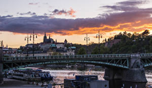 Picture Prague Czech Republic Houses River Bridges Sunrise and sunset Clouds Cities