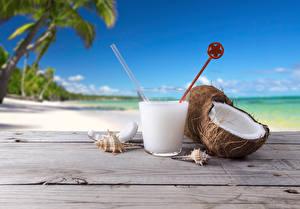 Fotos Kokos Cocktail Getränke Großansicht Strand Trinkglas Lebensmittel