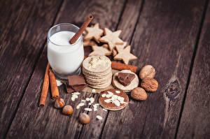 Bilder Nussfrüchte Kekse Getränke Zimt Großansicht Trinkglas Lebensmittel