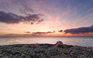 Fotos Spanien Himmel Morgendämmerung und Sonnenuntergang Meer Steine Küste Mallorca Wolke Cala d'Or Balearic Islands Natur