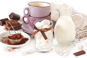 Fotos Süßware Schokolade Nahaufnahme Kannen Trinkglas Tasse Lebensmittel