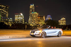 Pictures BMW Houses Silver color Cabriolet Night time 2015 228i (F23) convertible Cars Cities