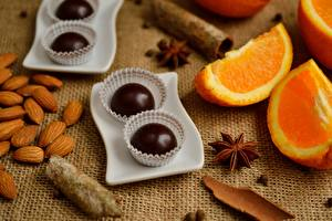 Wallpaper Chocolate Candy Orange fruit Nuts Closeup Food