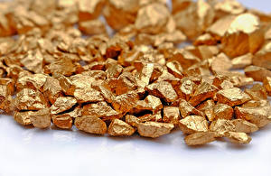 Images Gold Closeup Gold color gold metal mineral table white