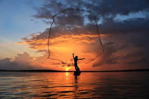 Images Thailand Sea Fishing Sky Sunrise and sunset Silhouettes Clouds Nature