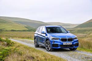 Desktop wallpapers BMW Light Blue Metallic Grass 2015 X1 20d xDrive M Sport automobile