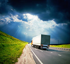 Pictures Lorry Roads Clouds Rays of light Back view Cars