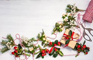 Fotos Feiertage Neujahr Ast Lichterkette Geschenke