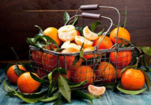 Fotos Obst Zitrusfrüchte Mandarine Weidenkorb Blatt Lebensmittel