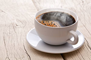 Fotos Kaffee Großansicht Tasse Untertasse Dampf Lebensmittel