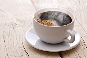 Fotos Kaffee Hautnah Tasse Untertasse Dampf Lebensmittel