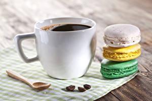 Fotos Kaffee Süßware Großansicht Macaron Tasse Lebensmittel