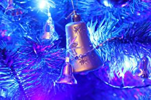 Fotos Feiertage Neujahr Ast Glocke Blau