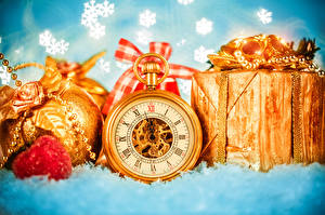 Pictures Pocket watch Holidays New year Balls Present Gold color Snowflakes