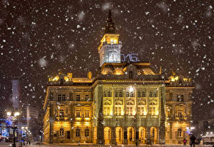 Wallpaper Houses Winter Serbia Night time Snowflakes Street lights Novi Sad Cities