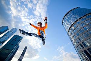 Wallpapers Man Sky Skyscrapers Jump Legs Sweater Sport