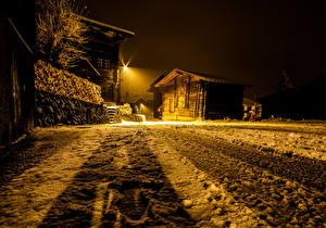 Picture Switzerland Building Winter Snow Night time Street lights Ritzingen Goms Cities