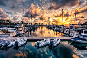 Pictures Marinas Evening Sunrises and sunsets Motorboat Yacht Clouds