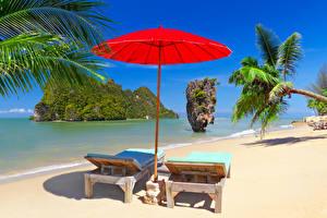 Bilder Thailand Tropen Küste Felsen Sand Sonnenliege Regenschirm Palmen Phuket Natur