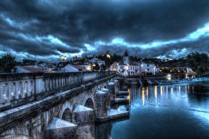 Tapety na pulpit Portugalia Budynki Rzeki Mosty Niebo HDR W nocy Santarem Miasta