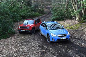 Desktop hintergrundbilder Subaru Jeep Zwei Metallisch Rot Hellblau Autos