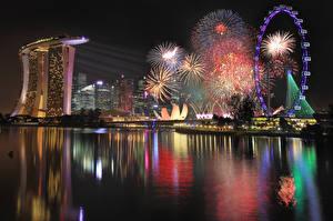 Photo Singapore Fireworks Night time Ferris wheel Marina Bay Sands Cities