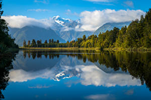 Pictures New Zealand Landscape photography Mountains Lake Forests Clouds Lake Matheson Nature