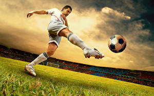 Pictures Footbal Man Fields Sky Ball Legs Uniform Knee highs Stadium Sport