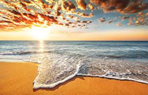 Picture Sunrises and sunsets Sea Ocean Coast Sky Horizon Clouds Nature