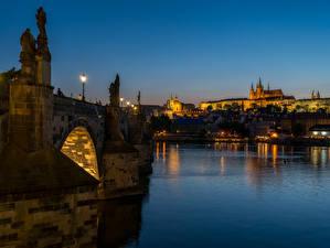 Wallpapers Czech Republic Prague Rivers Bridge Sculptures Night time Street lights Cities