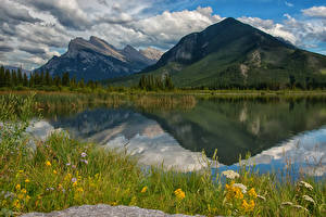 Pictures Scenery Canada Parks Mountains Lake Banff Clouds Grass Vermillion Lakes Nature