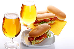 Photo Still-life Beer Hot dog Buns 2 Stemware White background Food