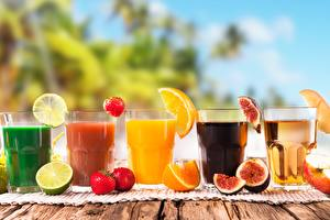 Images Juice Drinks Strawberry Orange fruit Common fig Lemons Highball glass Food