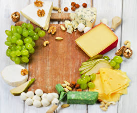 Pictures Still-life Cheese Grapes Nuts Pears Cutting board