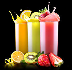 Pictures Drinks Juice Strawberry Chinese gooseberry Orange fruit Highball glass Three 3 Black background Food