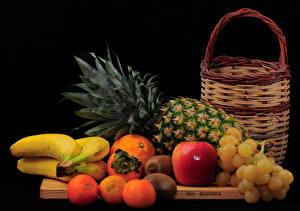 Pictures Fruit Grapes Pineapples Bananas Citrus Apples Black background Wicker basket Food