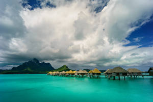 Image French Polynesia Tropics Sea Sky Mountains Bora Bora Clouds Bungalow Nature