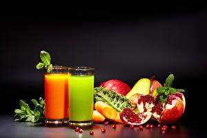 Picture Juice Fruit Pomegranate Highball glass Black background 2 Foliage Food