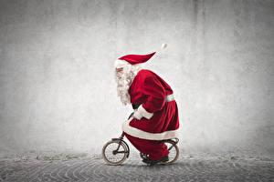 Hintergrundbilder Feiertage Neujahr Weihnachtsmann Uniform Fahrrad