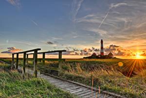 Hintergrundbilder Deutschland Leuchtturm Morgendämmerung und Sonnenuntergang Brücke Himmel Lichtstrahl Wolke Gras Westerhever Natur