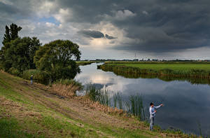 Desktop wallpapers Netherlands Rivers Evening Fishing Clouds Storm cloud Nauerna Nature