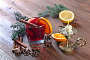 Fotos Neujahr Getränke Zitrone Kerzen Zimt Ast Lebensmittel