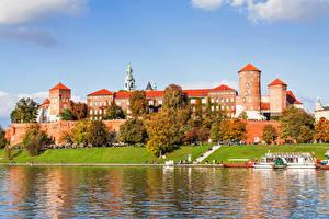 Pictures Poland River Castle Autumn Coast Krakow Trees Wawel Royal Castle Cities