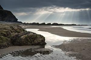 Bilder Vereinigtes Königreich Küste Landschaftsfotografie Stein Himmel Lichtstrahl Strände Wales Dunraven Bay Natur