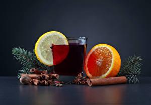 Fotos Neujahr Getränke Zitrusfrüchte Zimt Nussfrüchte Orange Frucht Zitrone Trinkglas Ast Lebensmittel