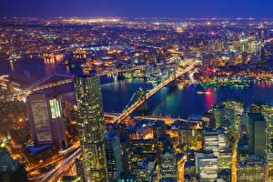 Fotos Vereinigte Staaten Haus Fluss Brücken New York City Manhattan Megalopolis Nacht Von oben Städte