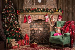 Pictures New year Holidays Fireplace Christmas tree Socks Wing chair Present