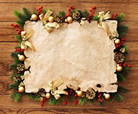 Fotos Feiertage Neujahr Vorlage Grußkarte Ast Kugeln Bretter Zapfen Blatt Papier