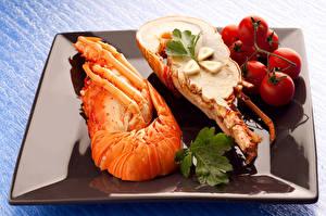Hintergrundbilder Meeresfrüchte Hummerartige Tomaten Knoblauch Blattwerk Teller
